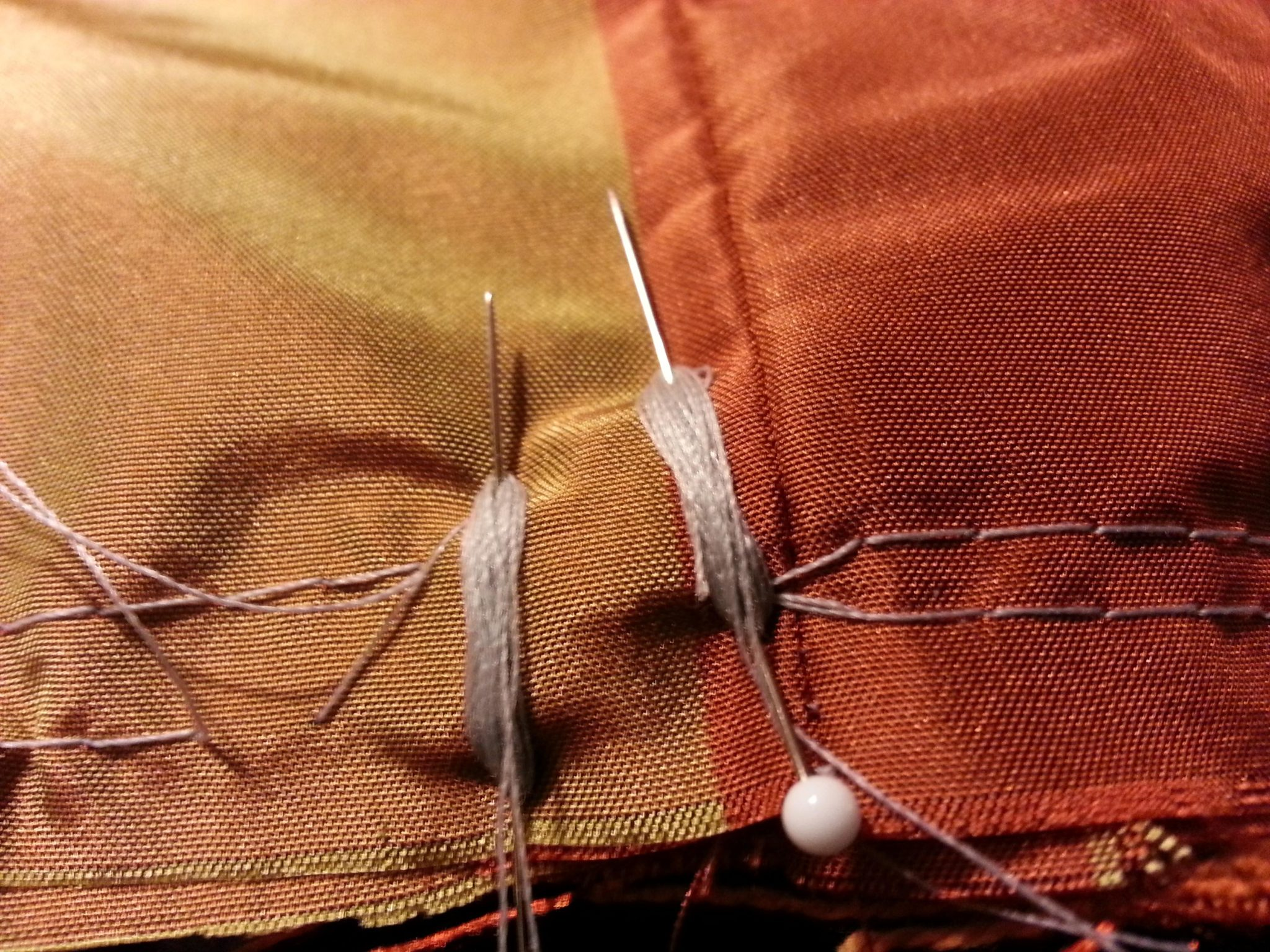 securing the threads for gathering the ruffles