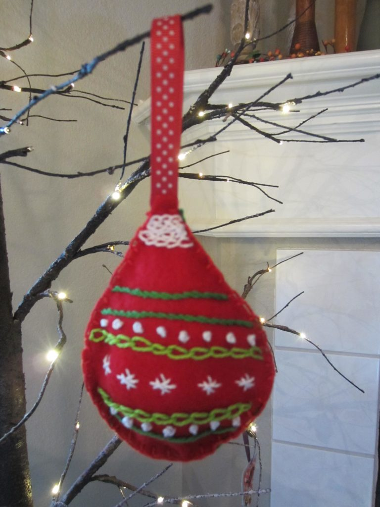 The finished retro embroidered felt ornament