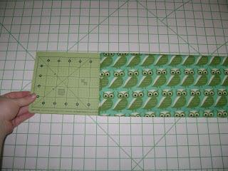 Create Kids Couture uses a standard quilter's ruler as a template to fold fabric