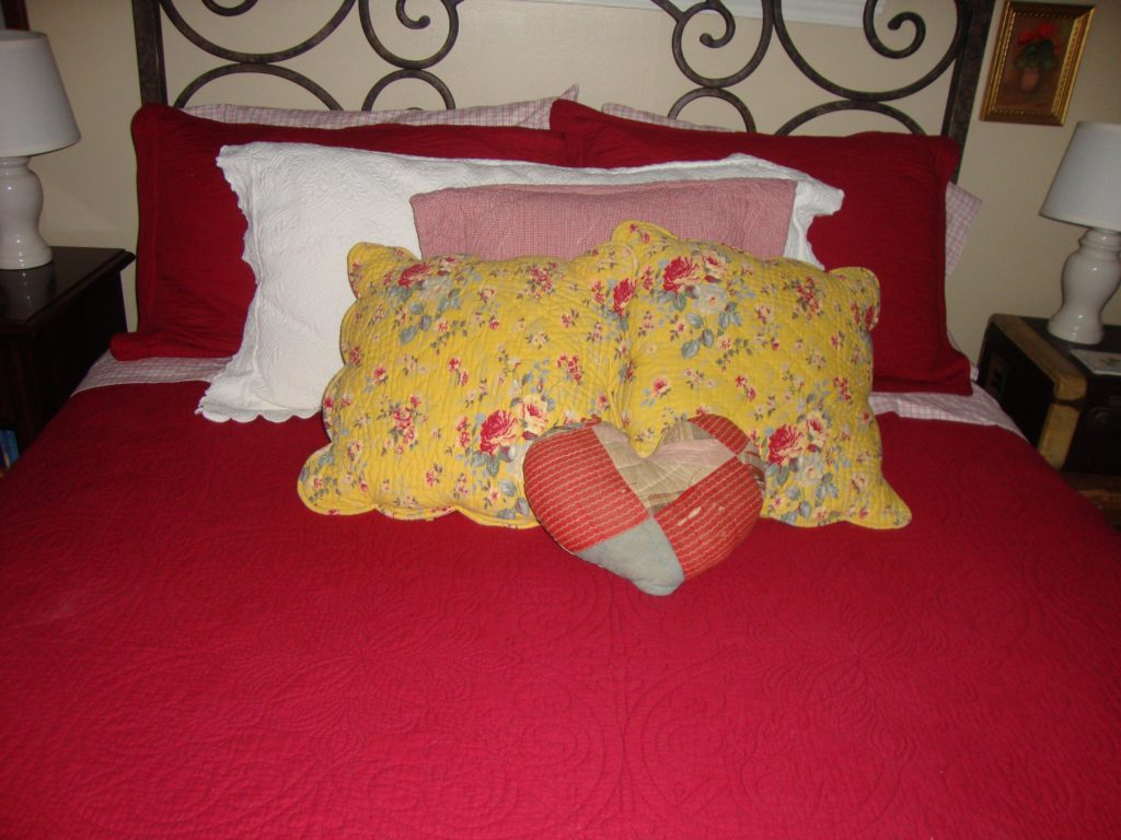 pillow on bed with yellow pillows