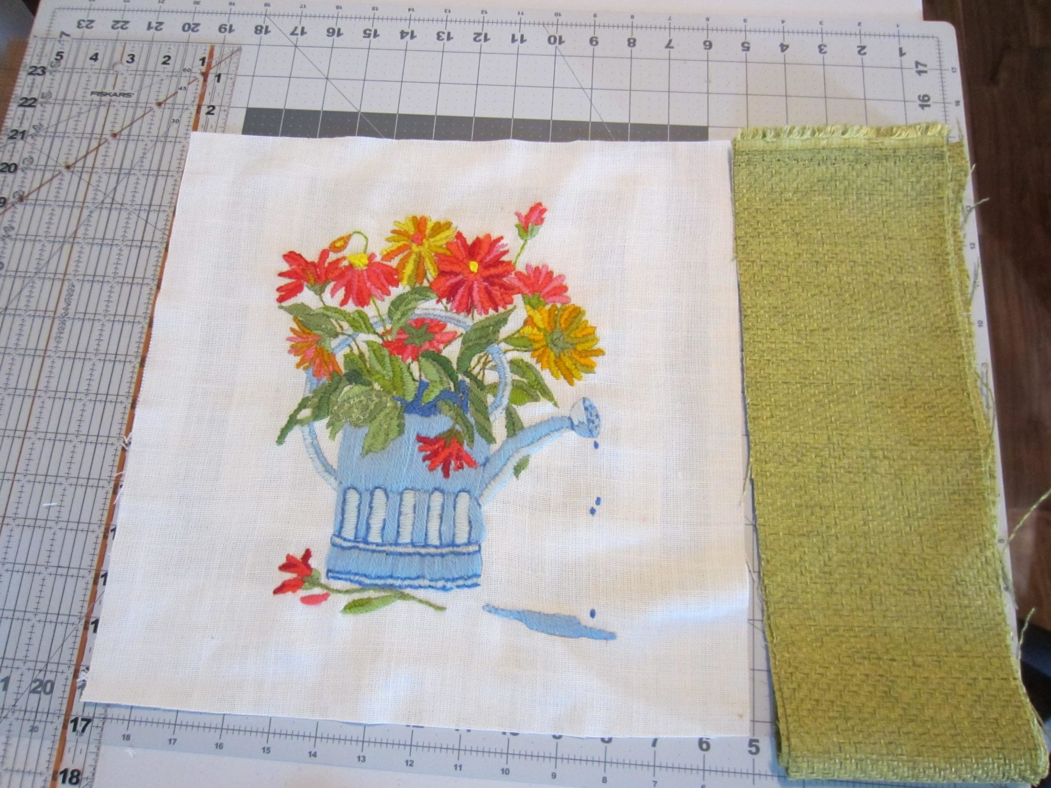 Adding fabric to the piece to make the pillow top