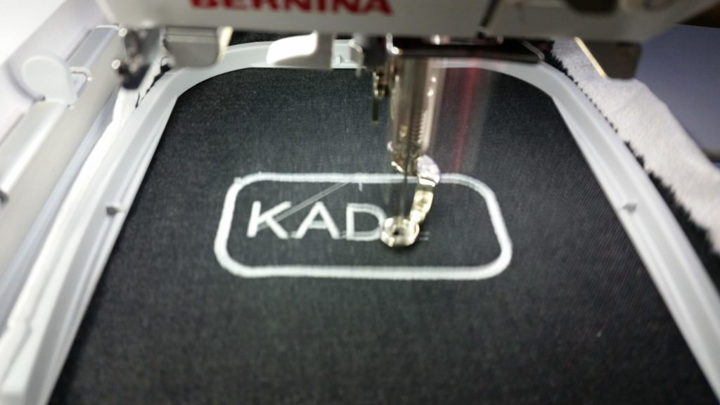 The stitching begins for Kaden's label on his tool bag