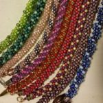Samples of many kumihimo ropes with beads
