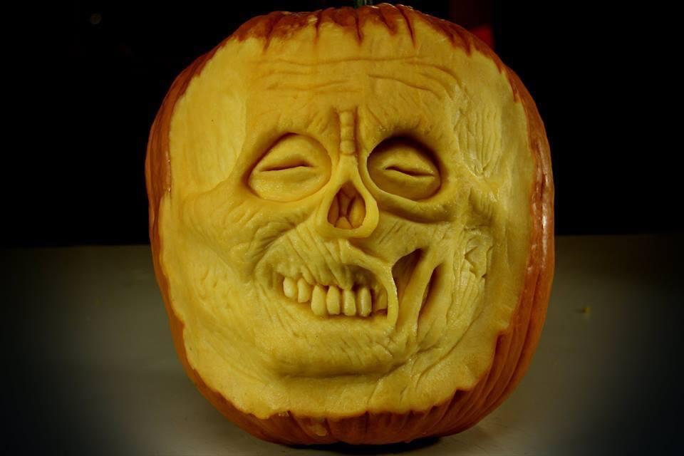 Pumpkin sculptor Paulo Machado and one of his zombie pumpkins