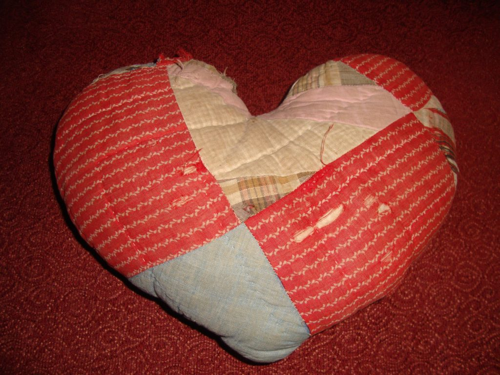 heart pillow made from distressed quilt