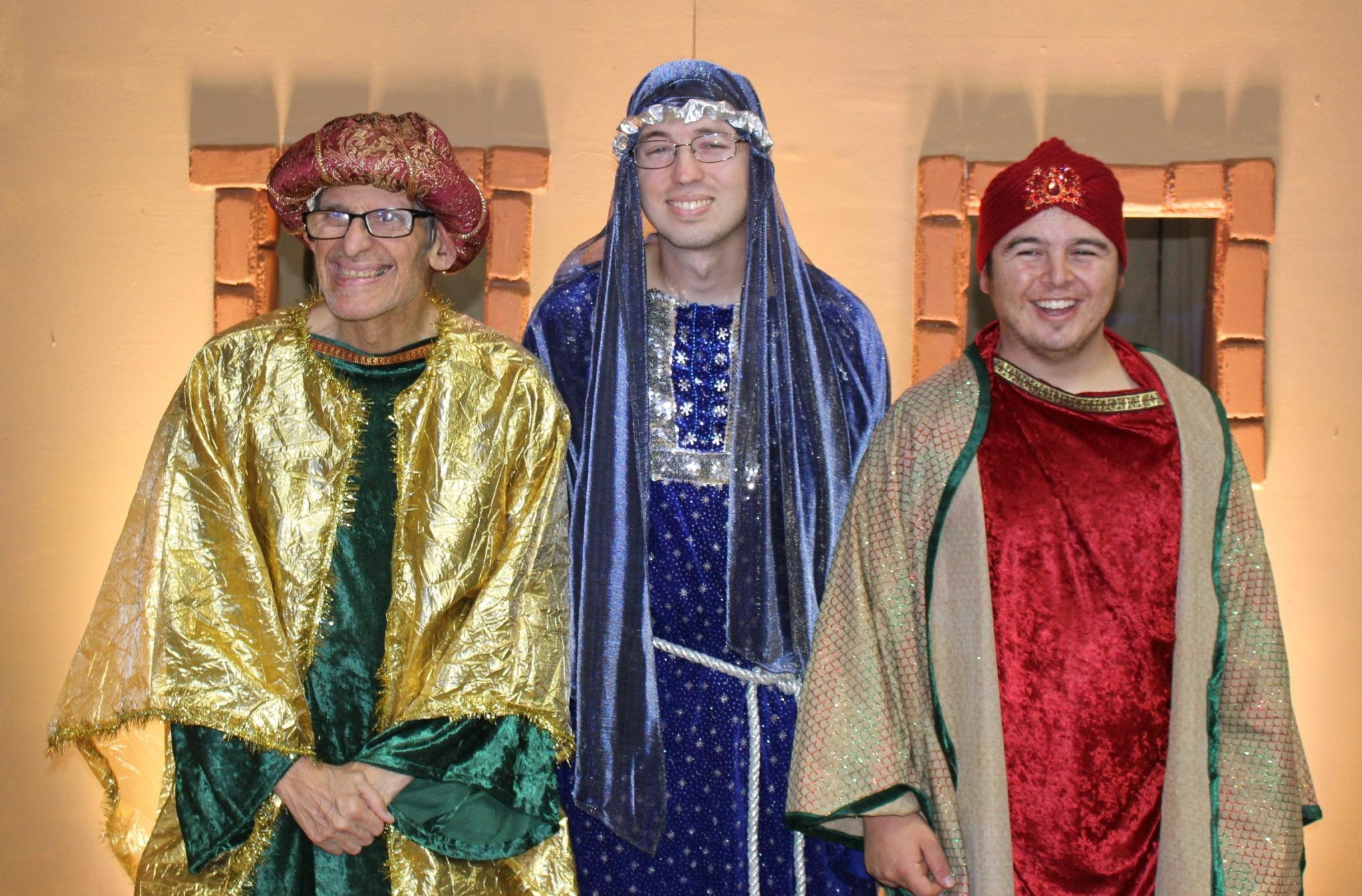The three wise men in their outfits and hats