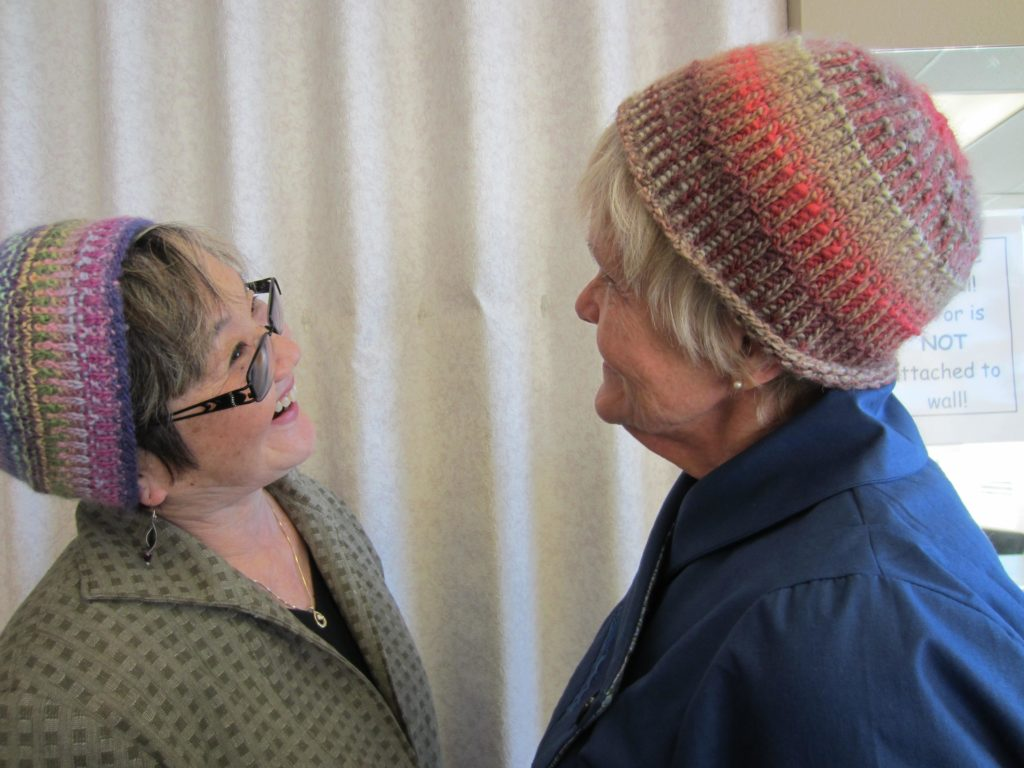Carole and Jean with their knitted hats