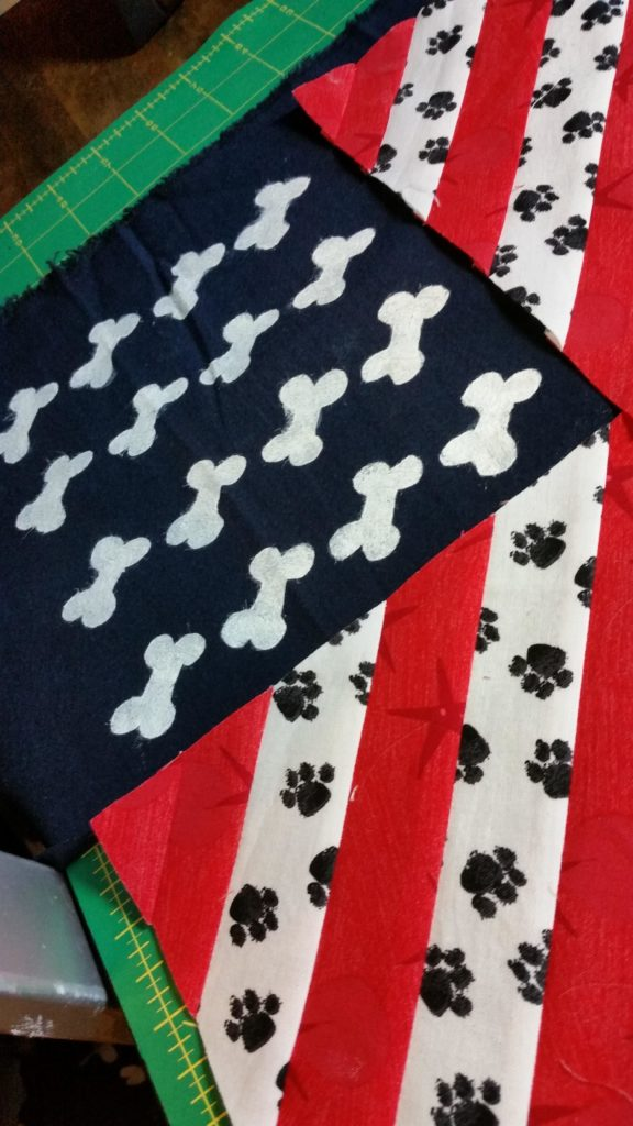 Dog bone stars and puppy print stripes on this scarf