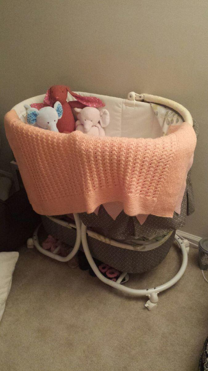 Finished baby blanket draped over the bassinet waiting for Jaelynn to arrive!