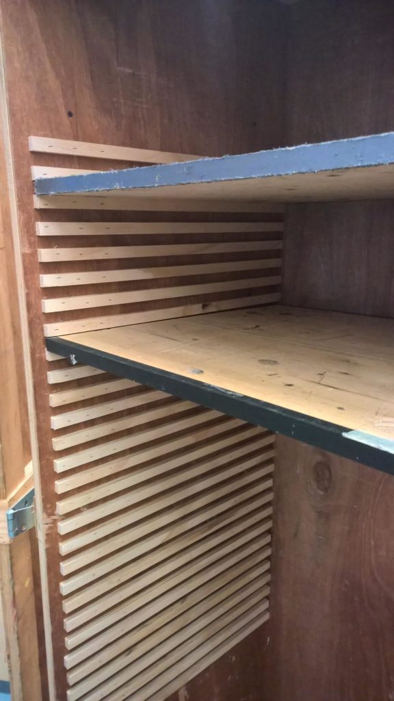 Seeing how the shelves fit into their new grooves
