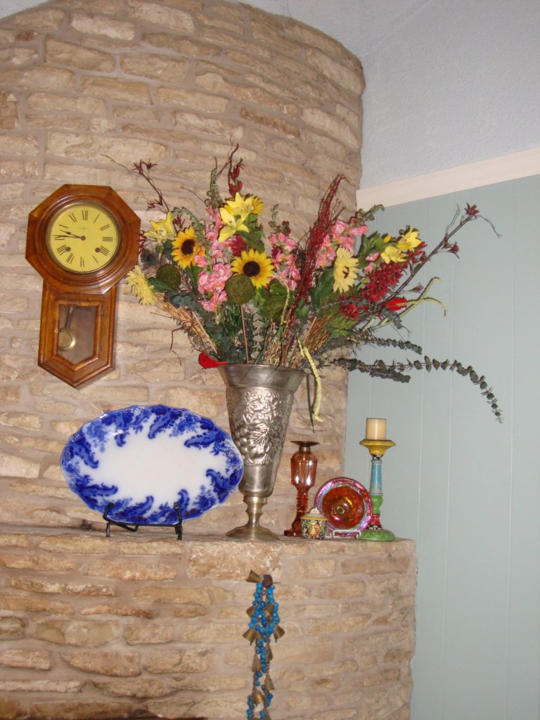 Strategically place something tall on one side of your mantel