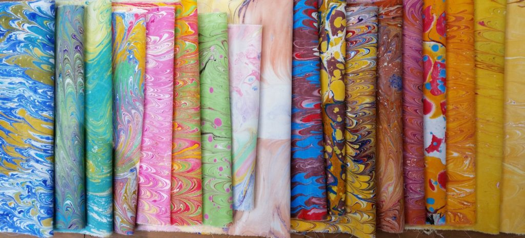 collection of completed marbled fabrics