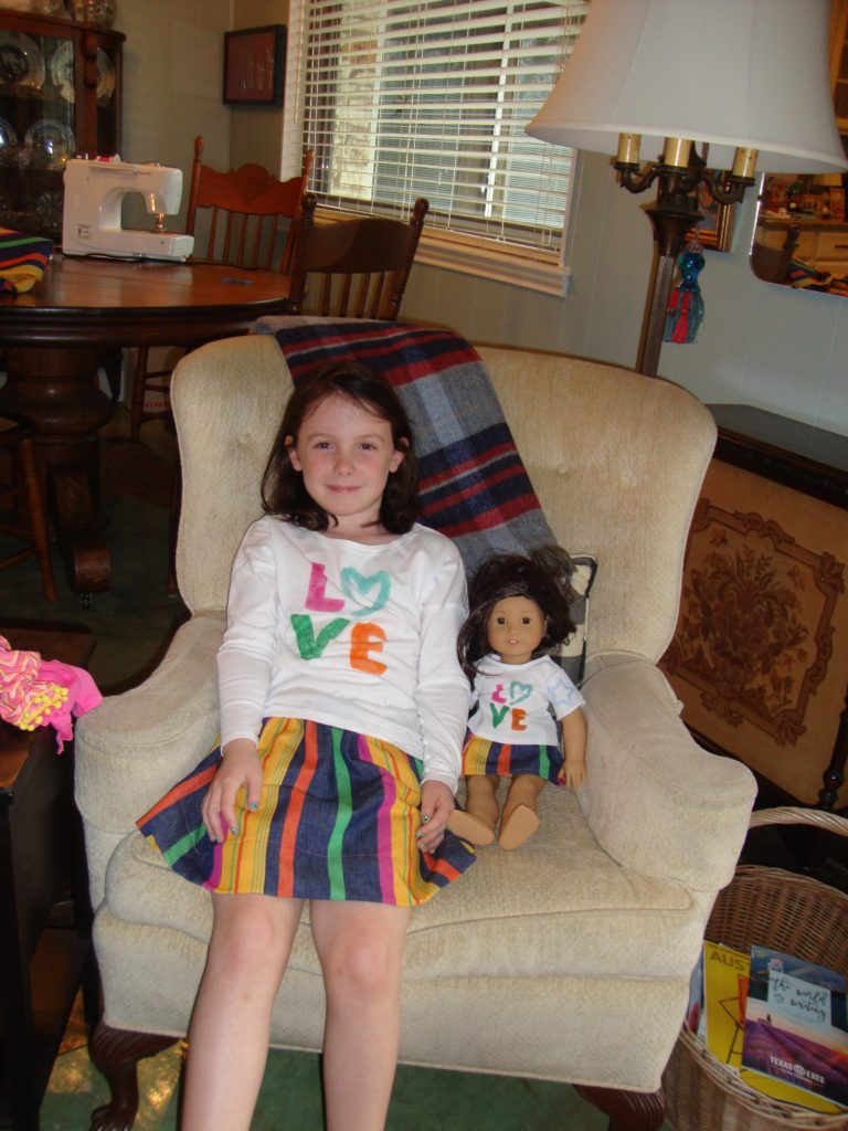 Love Matching Outfits - a girl and her doll have matching outfits!