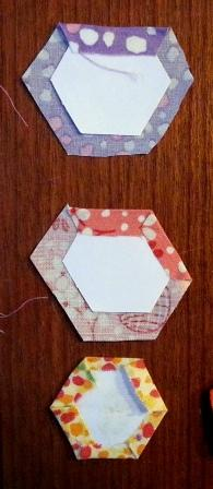 Just around the paper hexagons, leaving a 1/4 seam allowance