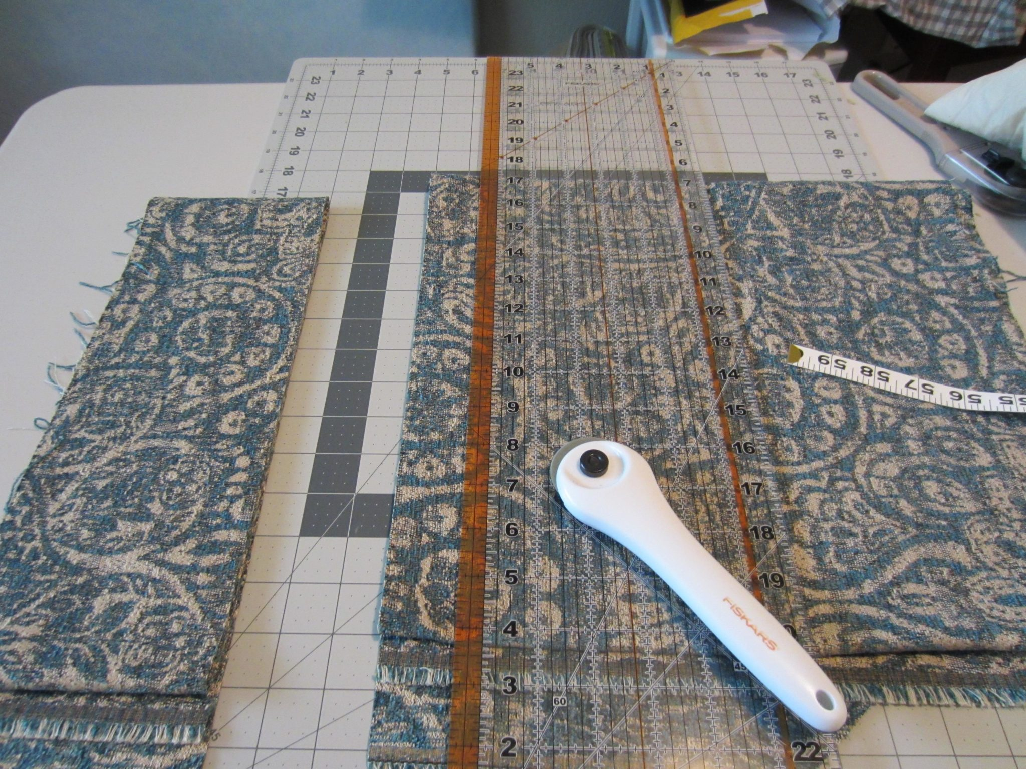 Cutting the fabric to finish the top
