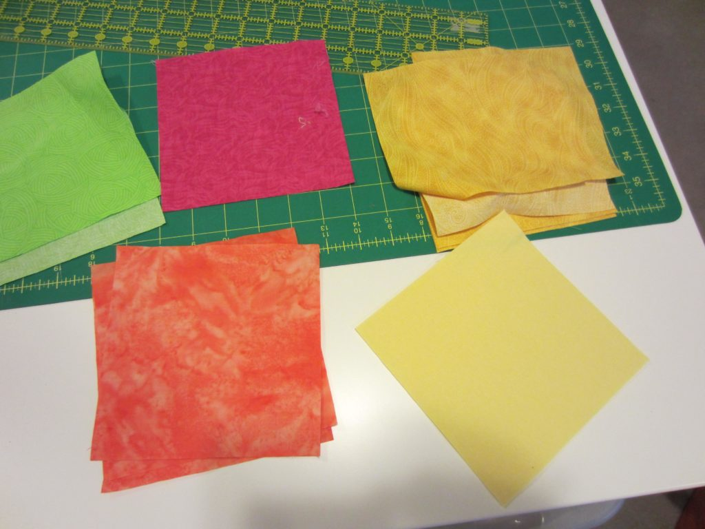 Cutting out the solid color squares for the quilt