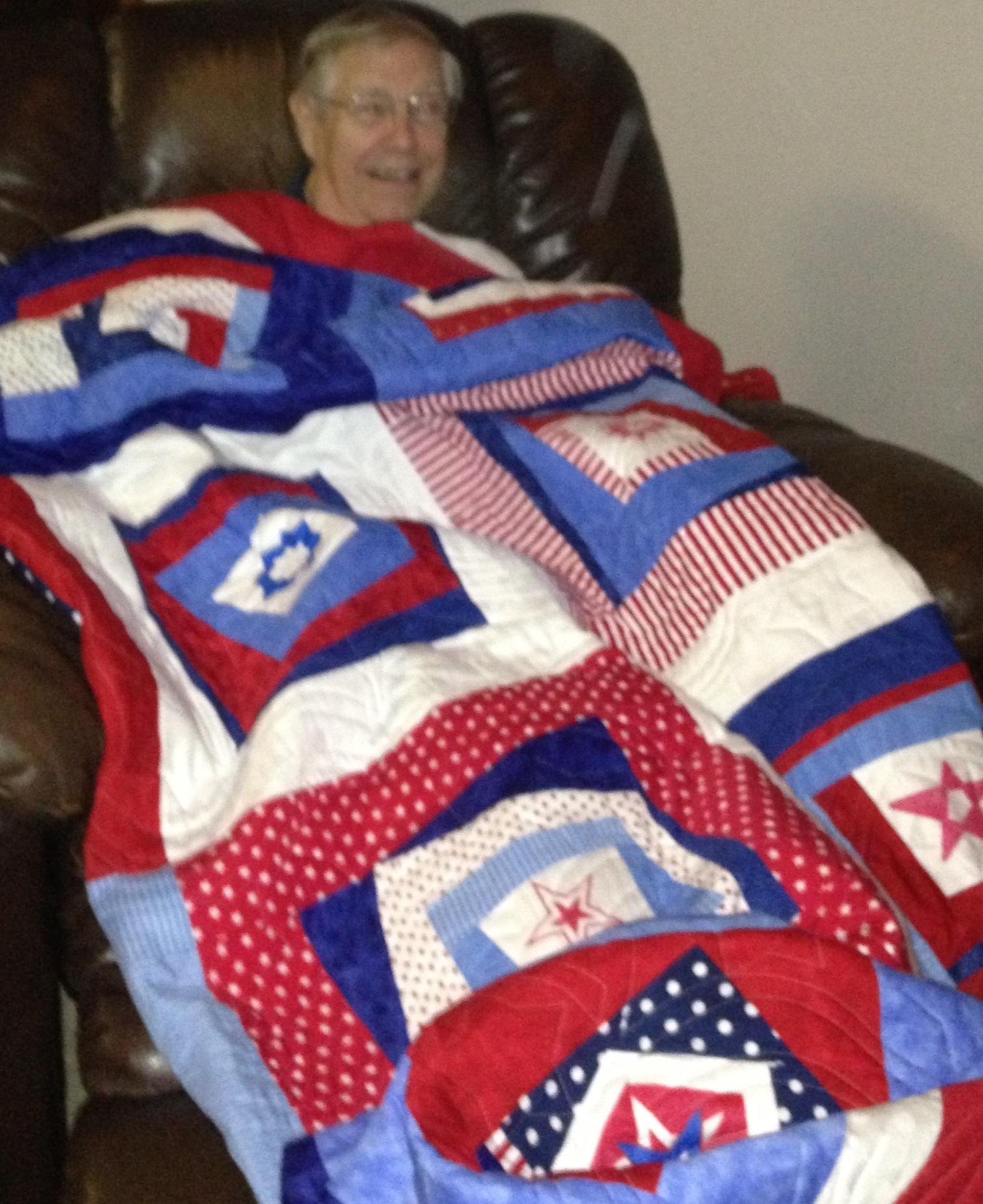 Wrapped up with the quilt made for him