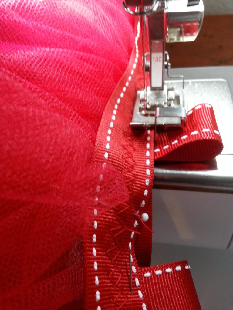 Sewing on loops that will attach to the harness