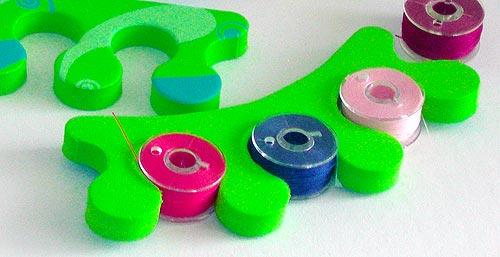 organize bobbins with toe separators made for pedicures