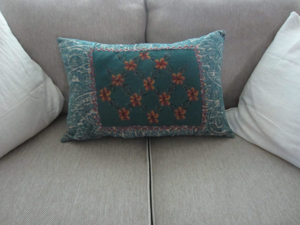 upcycled needlepoint pillow