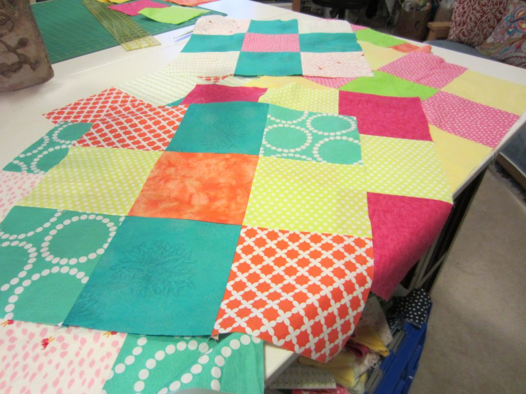 The first nine patch squares all sewn together
