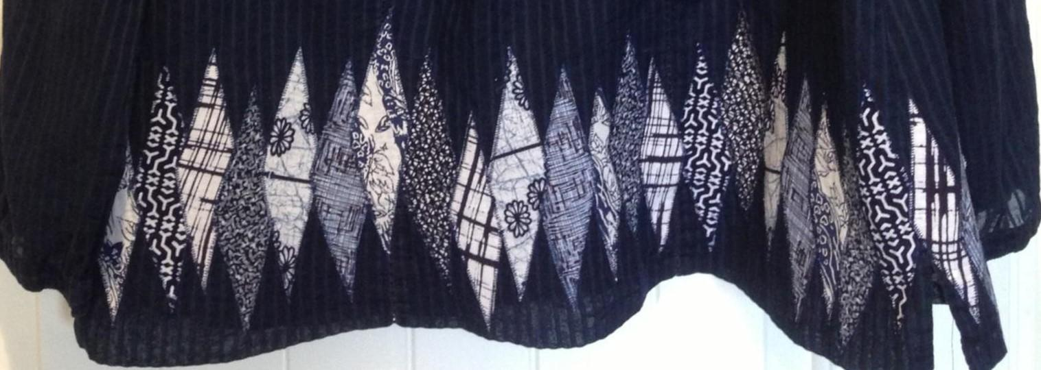 Close up of the blouse with embellishments