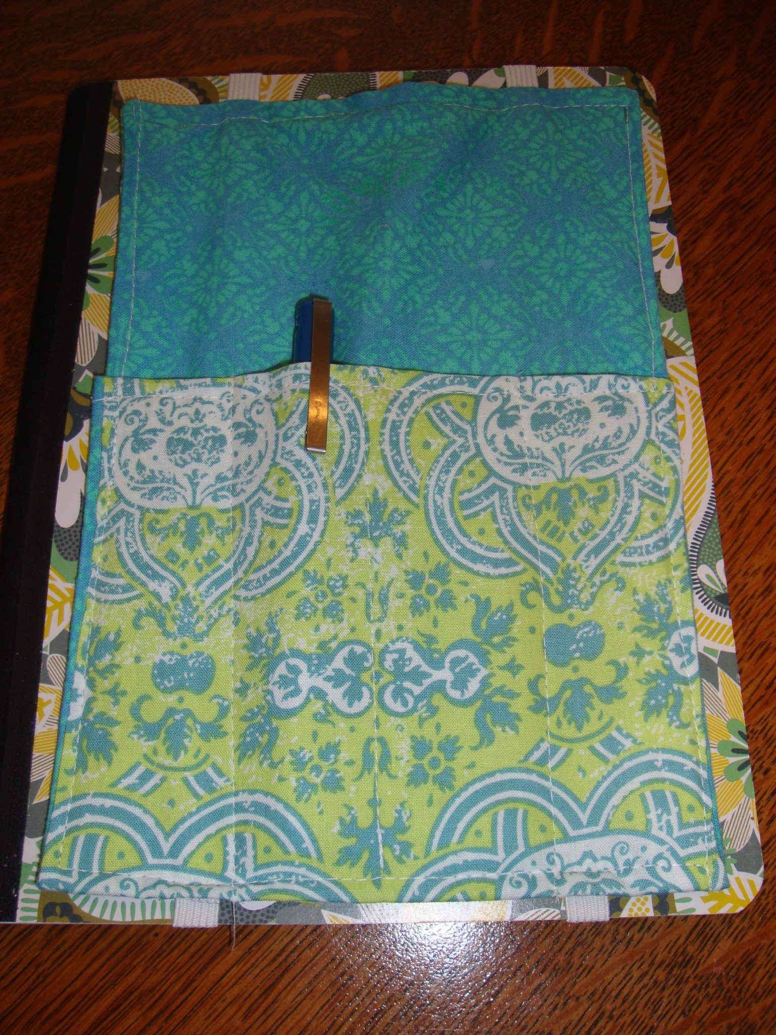 Turquoise and yellow pen quiver