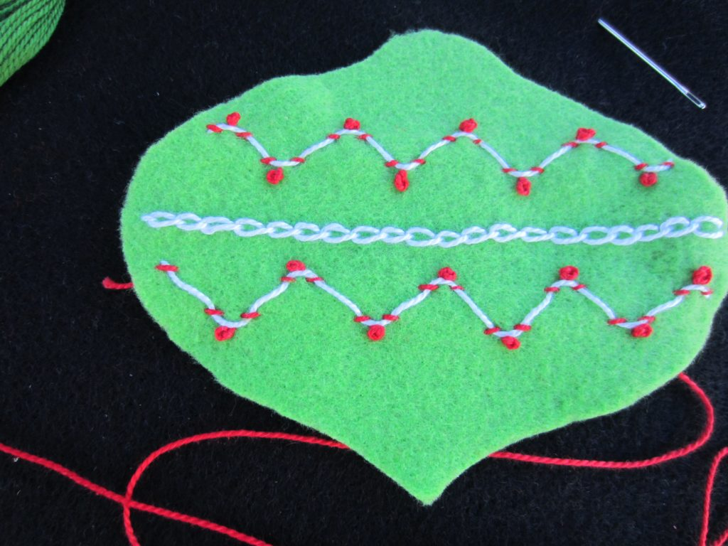 All of the French knots are added to the Laced Whipping Stitch