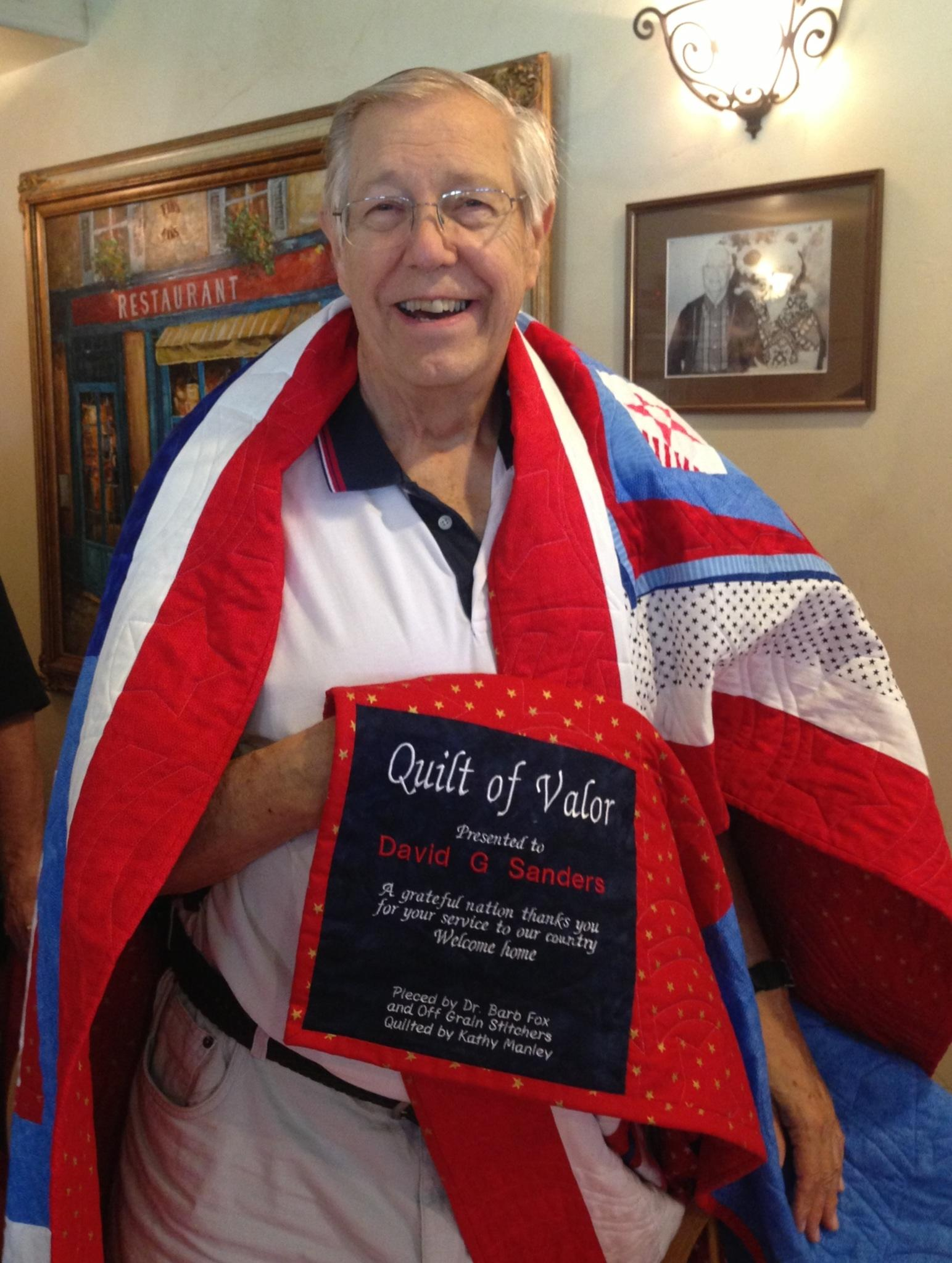 Quilts of Valor quilt with a veteran