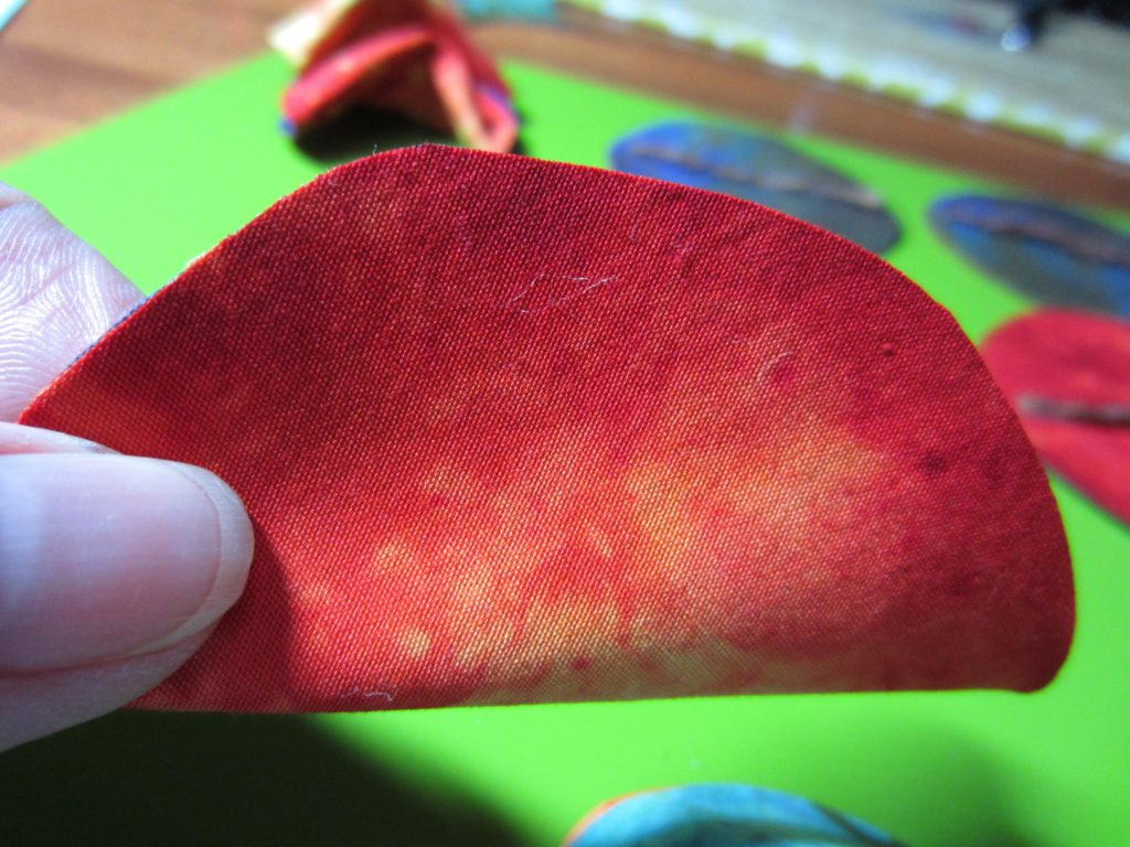 When the glue is dry, gently shape into a fortune cookie shape