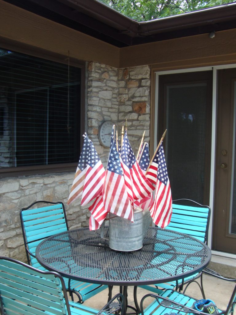 flags in a watering can