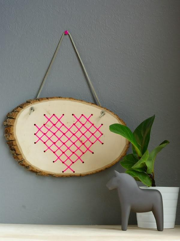 Heart crosstitched into wood