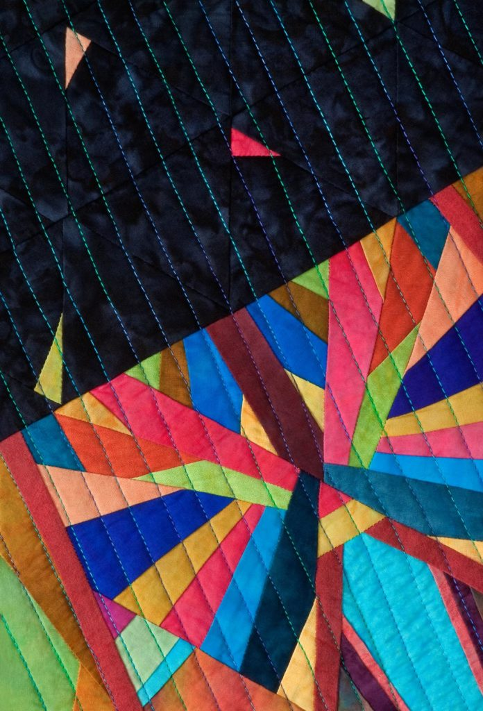 Close up of the paper pieced kaleidoscope quilt