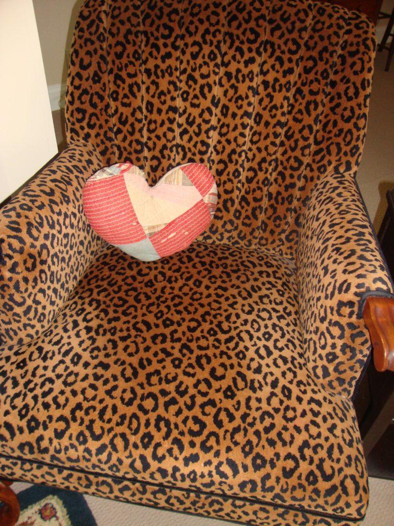 heart pillow on leopard chair