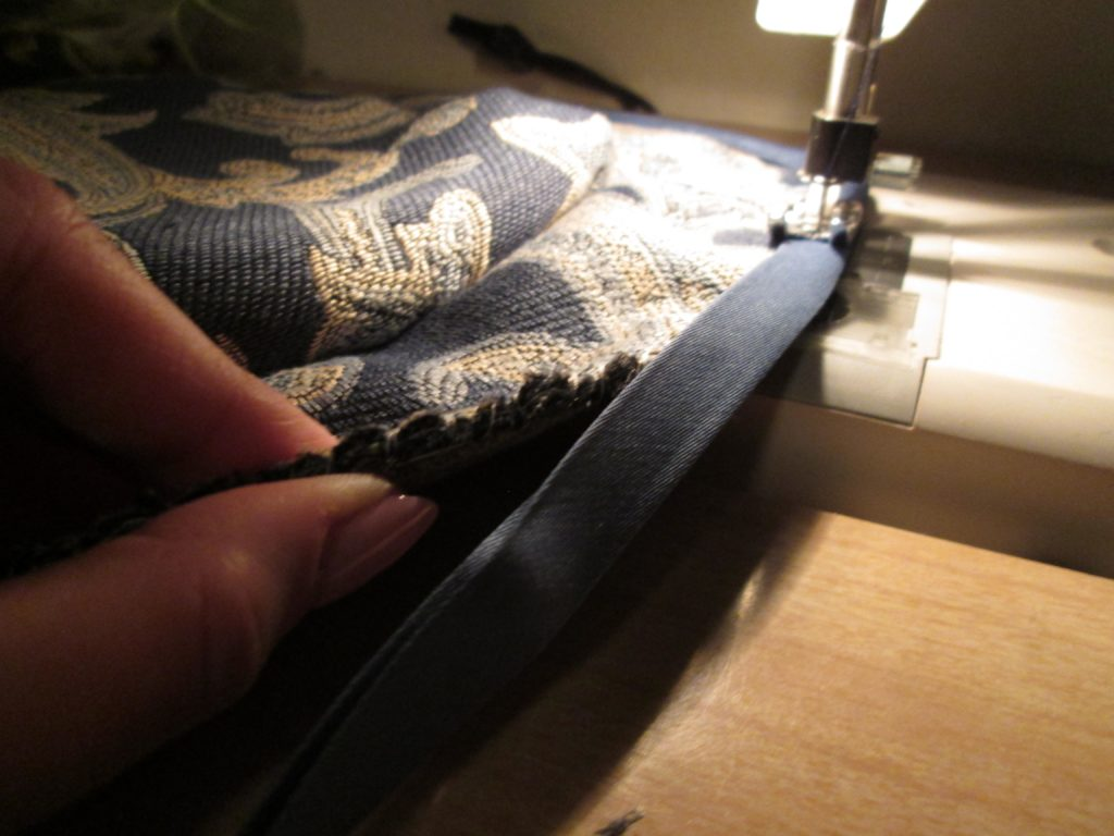 Sewing binding on the brim of the hat