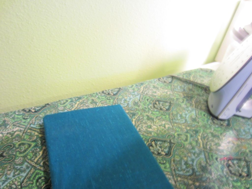 Bonding the fabric to the book with the iron