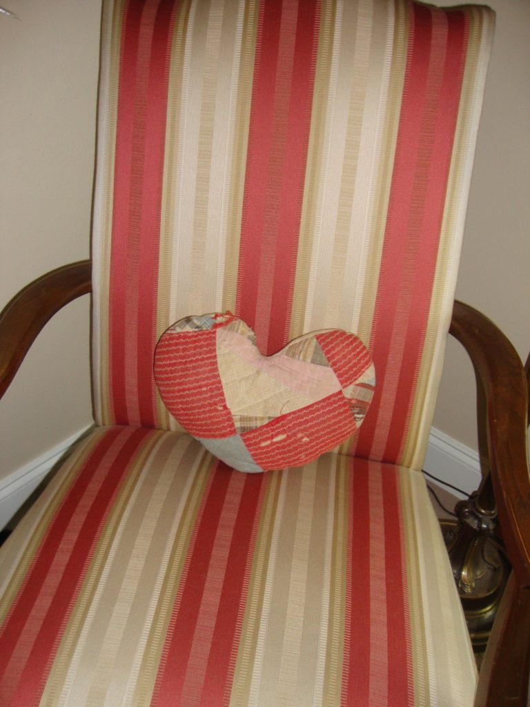 pillow on stripe chair