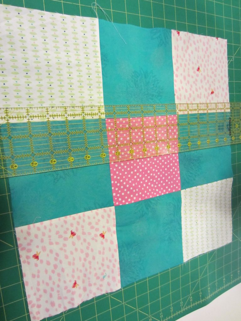 Cut each nine patch in half both ways to make 4 squares