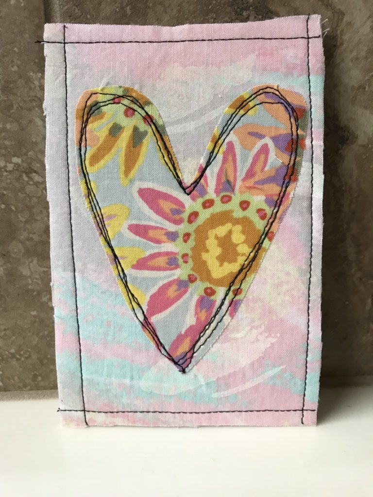 Add some stitching around the edges to border the card