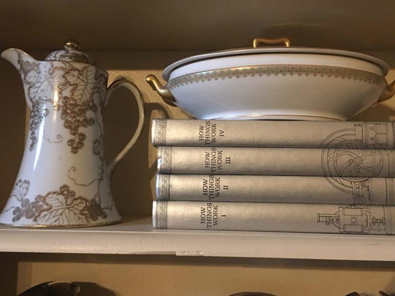 Metallic books on a shelf