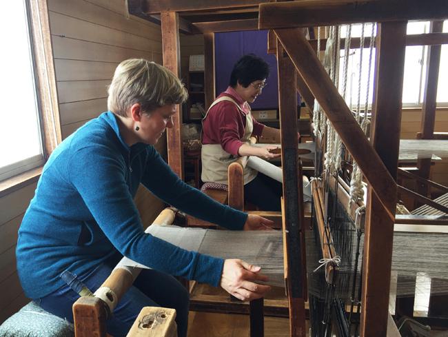 Carol demonstrating on a loom