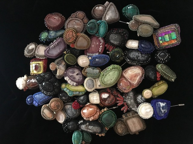 Collection of beaded cabochons by Pat