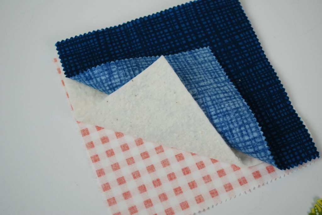 Layering fabric and batting for the base of the mug rug