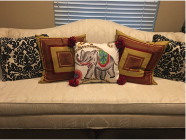 Loveseat with lots of decorator pillows