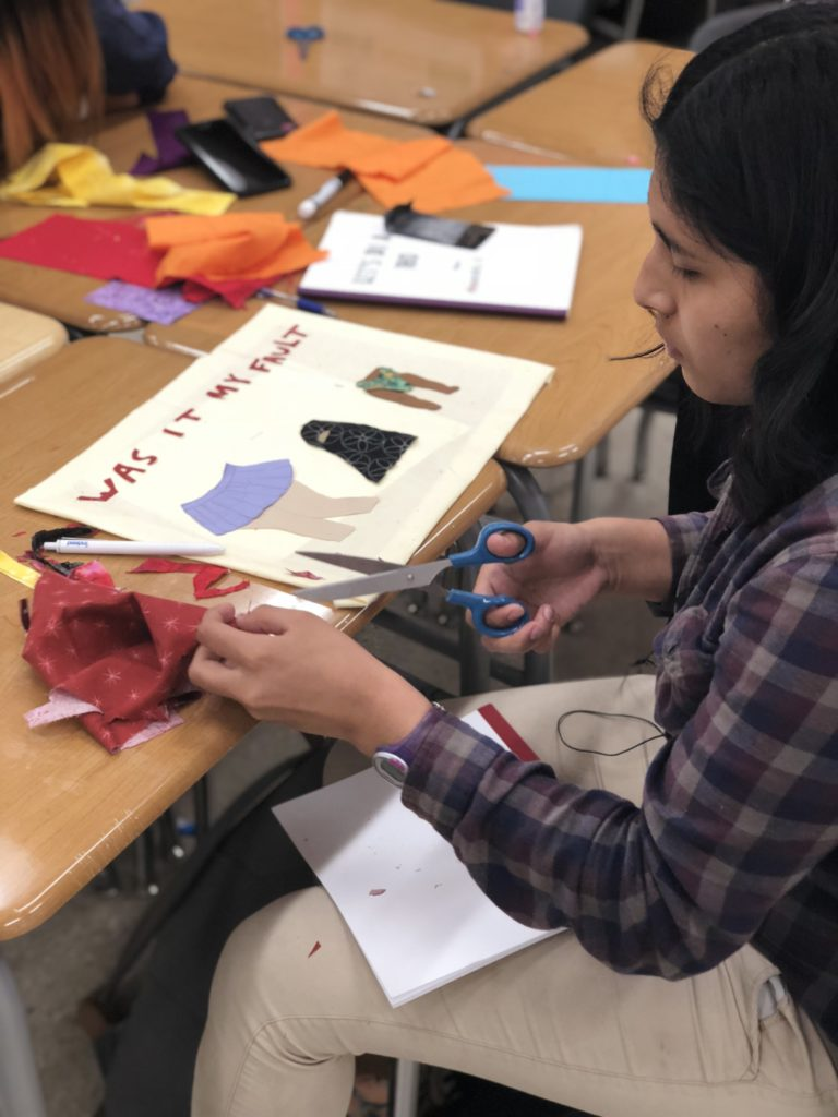 A young woman working on her quilt block