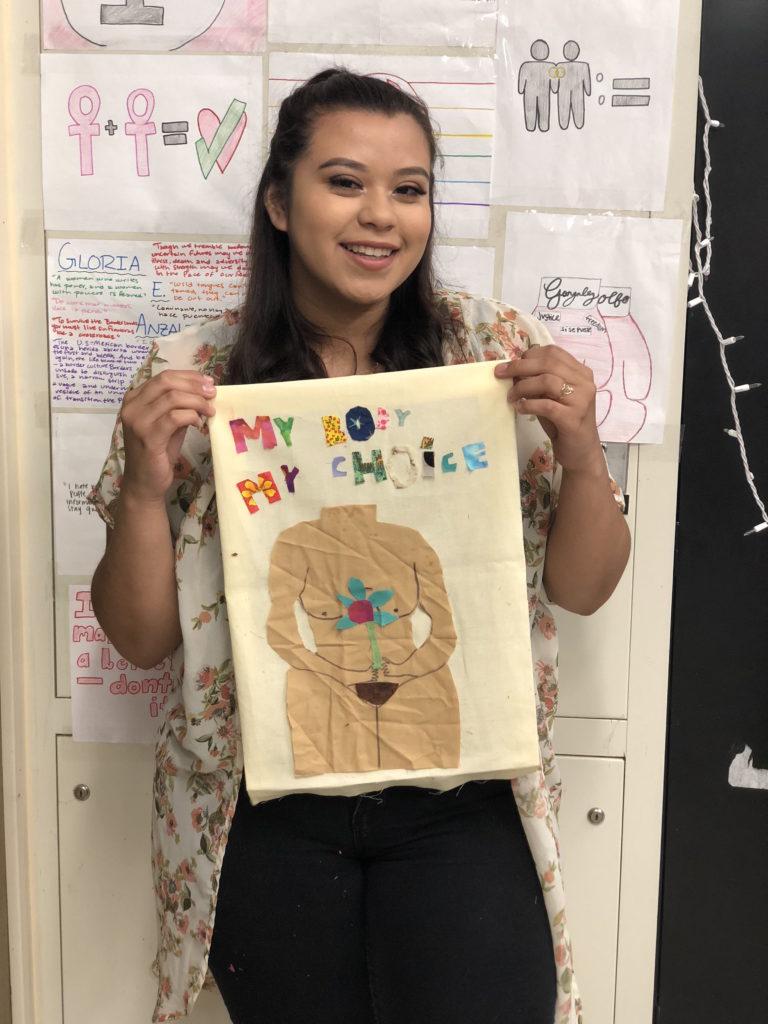 Girl holding her quilt block