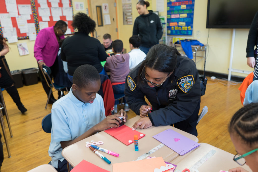Police officer helping make cards to send