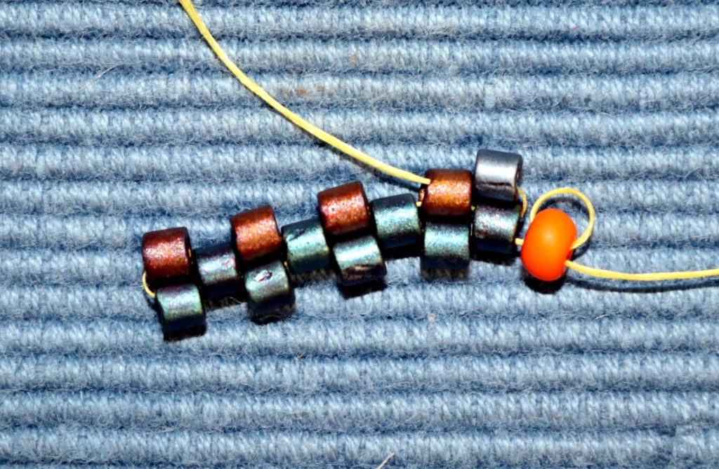 Even Count Flat Peyote Stitch 1st bead on the 4th row pulled snug