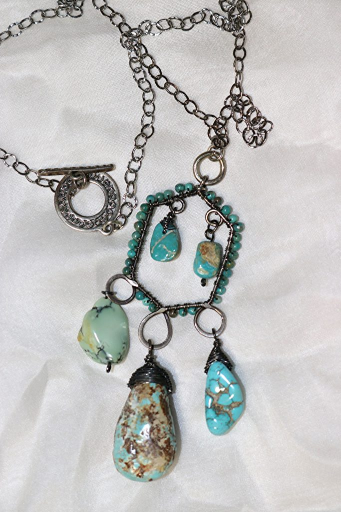Silver wire wrapped turquoise pendant