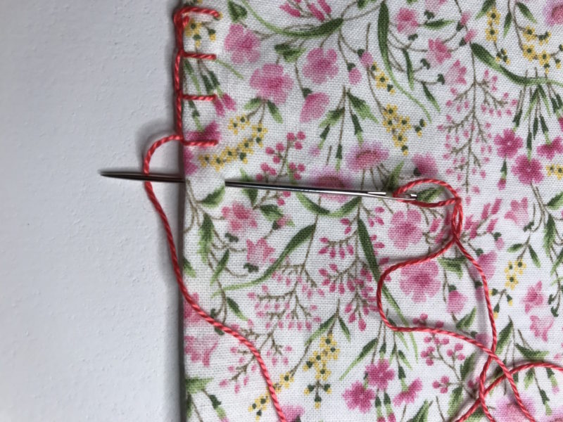 Showing the blanket stitch to finish the border of fabric